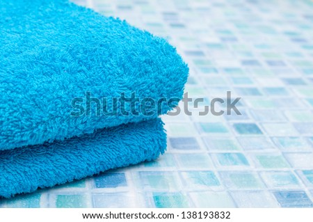 Blue Bath Towels on Bathroom Tiles