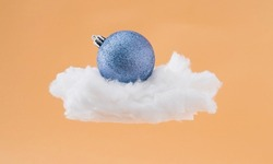 Blue bauble on the cloud. Abstract new year concept.