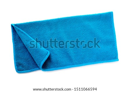Blue beach towel on a white background with shadow. Towel isolated on a white background. Folded beach towel in blue. Summer vacation concept.