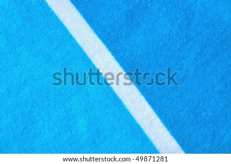 Blue beach towel useful as a background texture /  pattern