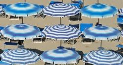 blue beach umbrellas, adriatic sea, pesaro, italy