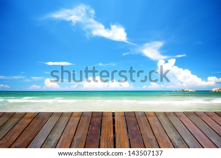blue beach with empty plank woods, suitable for product placement advertisement