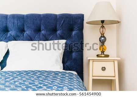 blue bed with soft headboard and bedside console with lamp #561454900