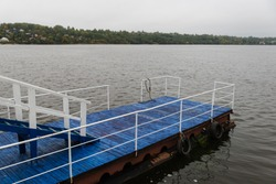blue berth. boat dock. car tires on the boat dock