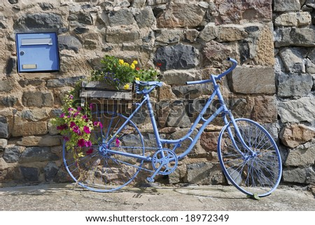 Blue bike in front of house in France
