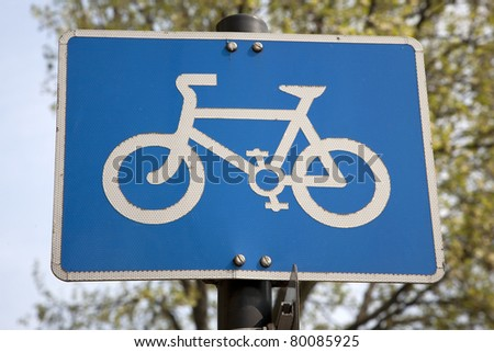 Blue Bike Lane Sign in Urban Setting