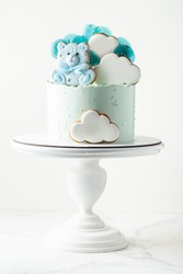 Blue birthday cake for a little newborn boy. Teddy bear shaped gingerbread cookies. Cloud shaped gingergread cookies with white icing with a free space for your text. Cake for a  baby shower