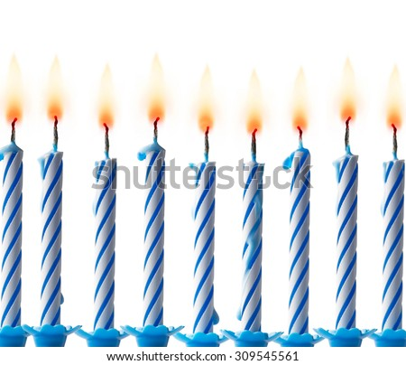 blue birthday candles with flames on a white background