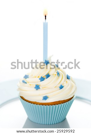 Blue birthday cupcake on a white plate