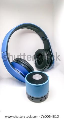 blue bluetooth headphone and portable speaker  #760054813