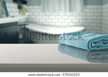 blue blurred background of bathroom interior with towel
