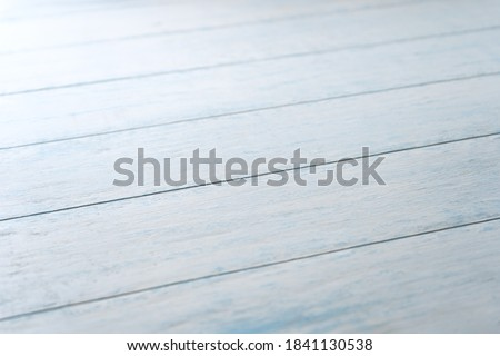 Photo of  Blue Board aged background in diagonal perspective.