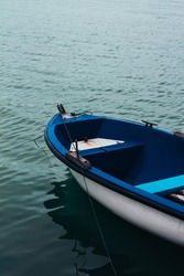 Blue boat floating on the sea