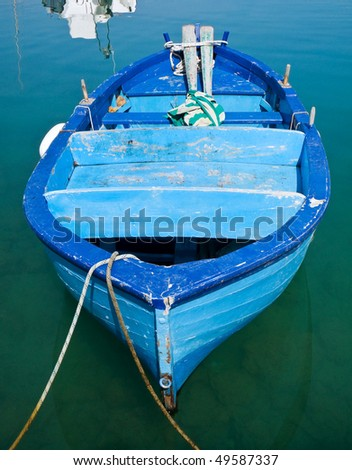 Blue boat in clear sea.