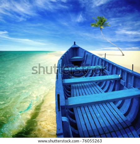 Blue boat on a beach