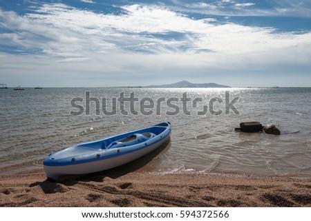 Blue boat on  the beach, Sharm El Sheikh, Nabq bay, Egypt #594372566