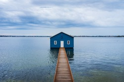 Blue boat shed in Crawley on the Swan River in Perth, Western Australia, Australia.