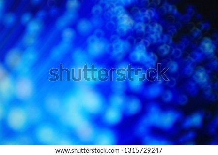 Blue bokeh defocused blur light background. modern light with circles and glows background for digital   #1315729247