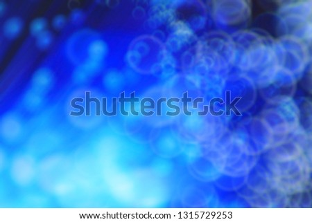 Blue bokeh defocused blur light background. modern light with circles and glows background for digital   #1315729253