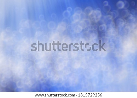 Blue bokeh defocused blur light background. modern light with circles and glows background for digital   #1315729256