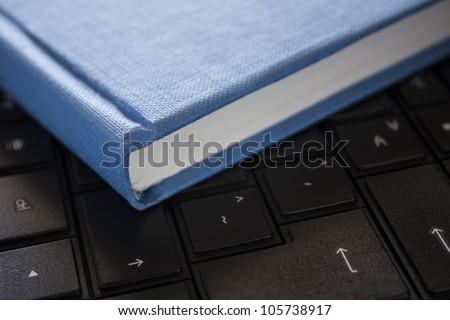 blue book on black computer