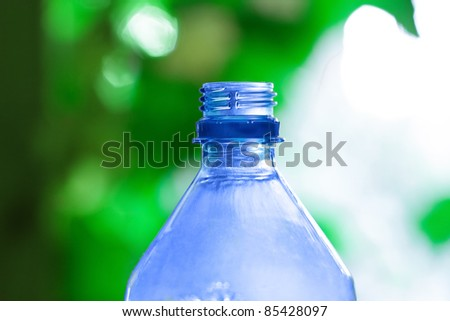 blue bottle on a green background