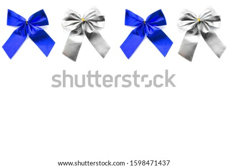 Blue bow and gray bow isolated on white background. Holiday bows. Gift bows. New Year's ribbons. Set of bows. Composition of festive ribbons.
