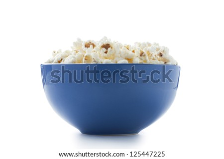 Blue bowl filled with popcorn isolated in a white background