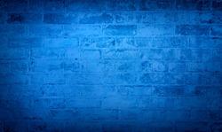 Blue brick wall background. Monotone texture of a flat brick wall close-up.