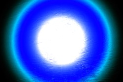 blue bright circle of light bizarre relief background, light tunnel with bright light at the end