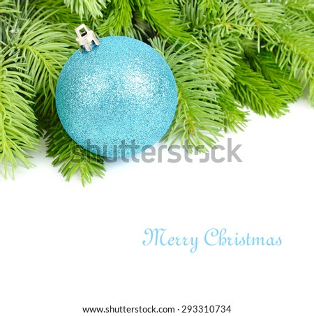 Blue brilliant Christmas ball on fluffy branches of a Christmas tree on a white background. A Christmas background with a place for the text.