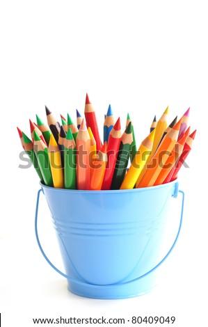 Blue bucket with color pencils