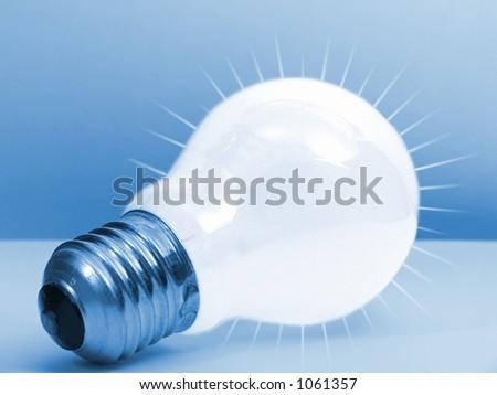 Blue bulb - rays - stock photo