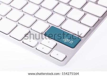 Blue button with word 'sign in' on keyboard