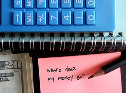 Blue calculator, cash money, pencil, pink note with text written WHERE DOES MY MONEY GO?, concept of find out spending leaks to fix them and boost saving