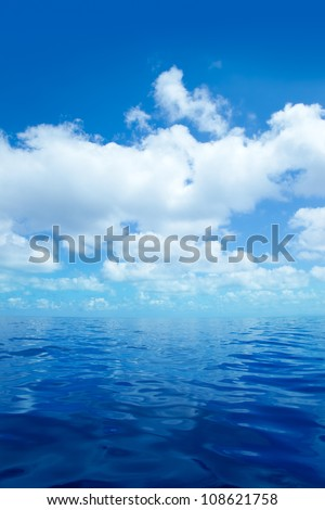 Blue calm sea water in offshore ocean with clouds mirror surface #108621758