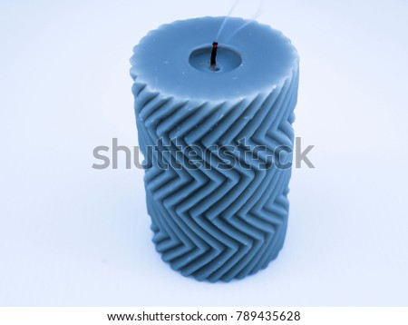 Blue candle with small smoke and zigzag pattern #789435628