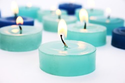 Blue candles on gray background.