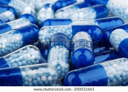 Blue capsules (pills) background