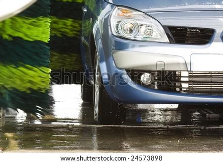 Blue car during washing process - stock photo