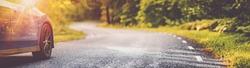 blue car on asphalt road in summer