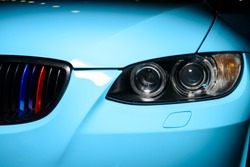 Blue car with headlight, grille and bumper