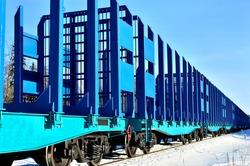 blue cargo train on the move in winter