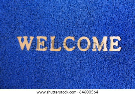 blue carpet welcome mat. - stock photo