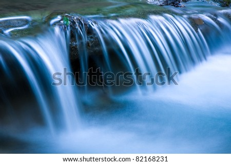 Blue cascade of mountain river
