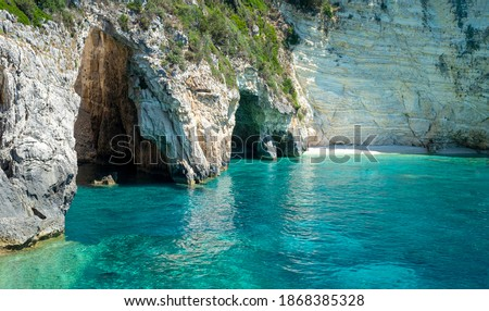 Blue Cave (Galazio Spileo): three exceptional sea caves which are communicating each other. They owe their name to the variety of shades of blue and to the clear waters. Paxos island. Greece. Stockfoto ©
