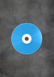 Blue CD - DVD label mockup template isolated on concrete background