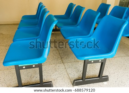 Blue chair for sitting patient waiting in the hospital #688579120