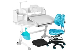 Blue chair, gray school table, blue basket, desk lamp and black support under legs on the white isolated background.