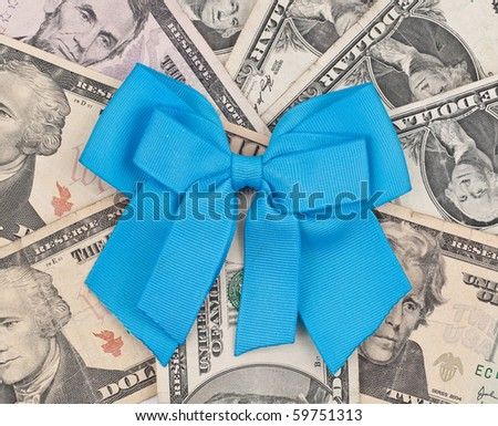 Blue Charity Ribbon on Pile of Money